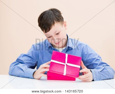 The Boy Opens A Box Of Surprise