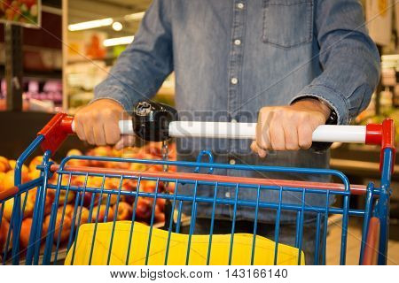 Supermarket Customer's Hand Close-up With Fruits On Background