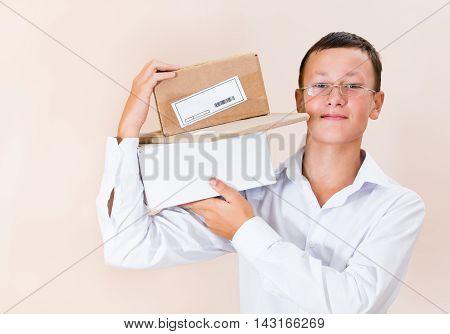 Boy Postman With A Parcel
