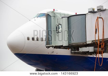 The Plane At Airport Loading Passengers