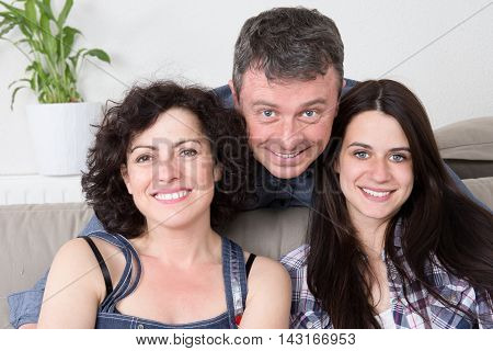 Couple With Their Teenage Daughter at home