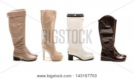 Collection of winter and autumn boots isolated on white background