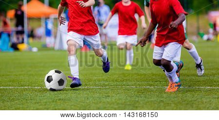 Boys playing soccer football match. International sport competition for youth soccer teams.