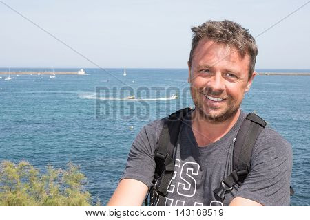 Handsome Male Posing In Front Of Sea Summer Vacation