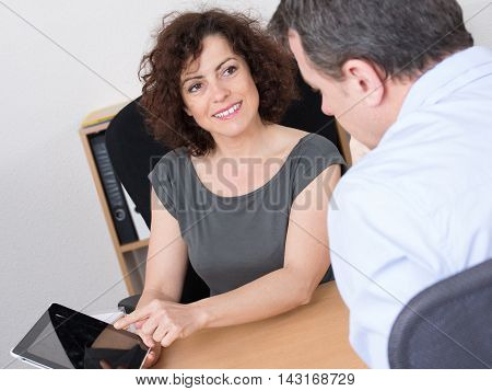 Business People Meeting In Office With Tablet