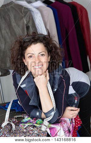 Portrait of a smiling fashion designer woman