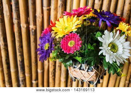 Colorful Fabric Flowers On Bamboo Wall