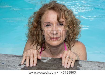 Woman On The Deck By The Pool