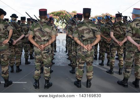 Military men at a parad under blue sky
