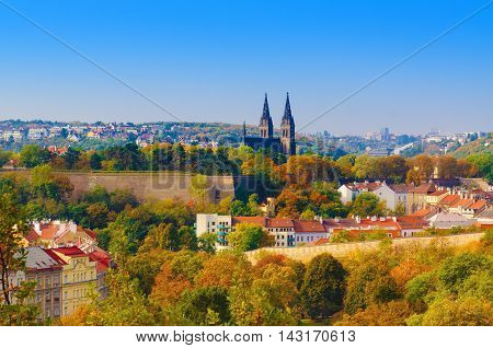 View to the Vysegrad in Prague, Czech Republic at autumn with cathedral and red roofs, travel seasonal background