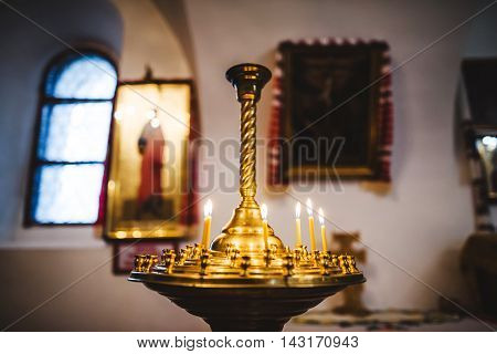 Gold church candle for meditation and pray.