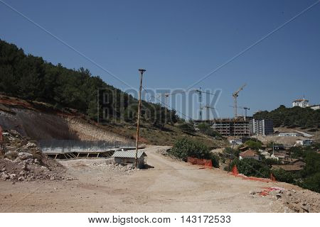 groundbreaking, bulldozers tearing rocks , rock drilling