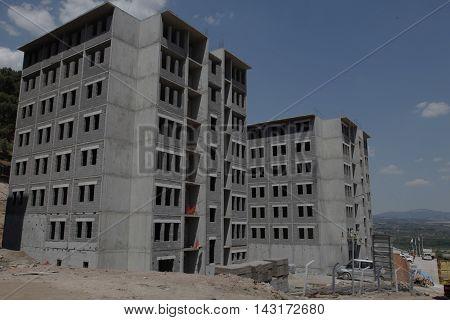 building construction site under a blue sky, gray concrete
