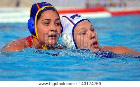Budapest, Hungary - Jul 16, 2014. KRIMER Kseniia (RUS, 5) fighting against MIRANDA DORADO Lorena (ESP, 7). The Waterpolo European Championship was held in Alfred Hajos Swimming Centre in 2014.