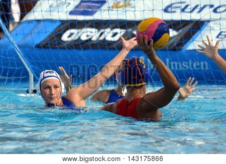 Budapest, Hungary - Jul 16, 2014. KARIMOVA Elvina (RUS, 4) defending against ESPAR LLAQUET Anna (ESP, 3). The Waterpolo European Championship was held in Alfred Hajos Swimming Centre in 2014.