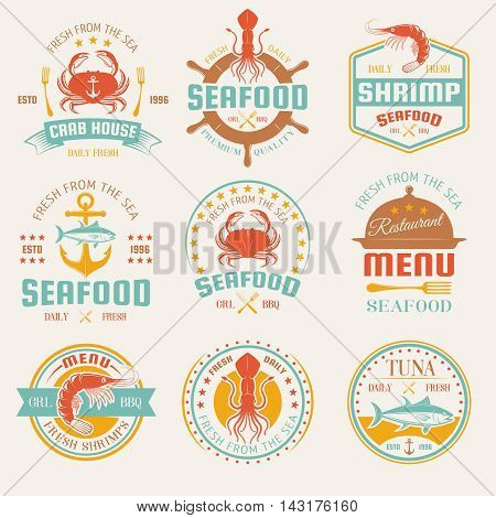 Seafood colored restaurant emblems with cutlery and cloche marine products anchor and helm isolated vector illustration