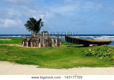 Central America Panama Traditional boat Kuna indians and homestead for animals on the San Blas archipelago