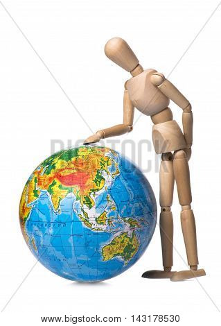 Figurine human hand touches the globe on a white background