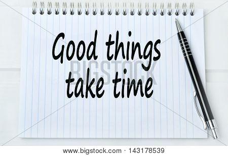 Good things take time on white ring binder notebook