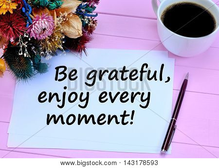 Be gratefulenjoy every moment on white paper