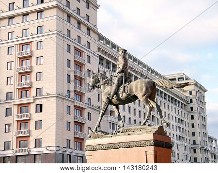 Monument to Marshal Zhukov on the background of the hotel Moscow in Moscow Russia