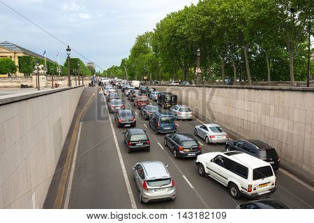 PARIS FRANCE - MAY 07 2015: Traffic in the historical center of Paris in rush hour France