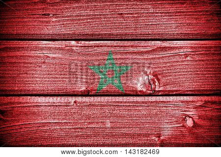 flag of Morocco painted on old grungy wooden background: 3d illustration