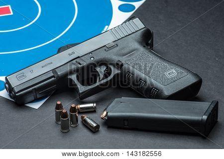 Las Vegas NV USA - January 25 2016: Closeup of Glock 17 semiautomatic handgun and 9mm amunition and magazine.