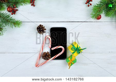 Mobile phones cones candy and gifts. Christmas chores. Pozdravlengiya friends on line. Modern Christmas present. Youth culture. Technology and time.