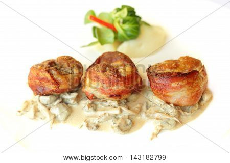 Meat in bacon with garnish gourmet restaurant food