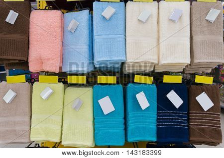 Towels Hang On Shelf In Supermarket Or Hypermarket With Blank Tag