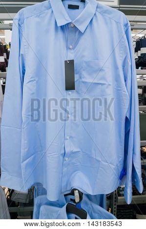 Blur Shirt On Hanger In Supermarket