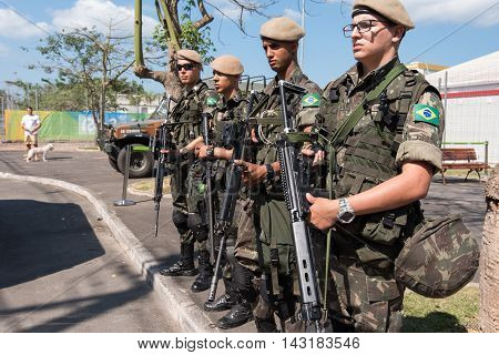 Rio de Janeiro, Brazil - August 4, 2016: Brazilian army soldiers guarding the Athlete Village as part of the security plan during the Olympic Games.