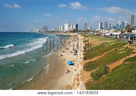 TEL AVIV ISRAEL - AUGUST 07 2016: Embankment and public beaches between Tel Aviv and Jaffa in summer