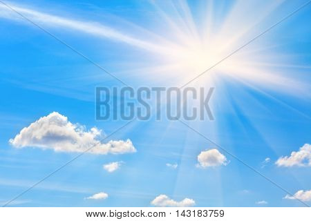 white clouds and bright sun on the blue sky