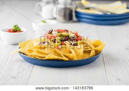 Vegetarian Nachos With Salsa And Sour Cream Dips