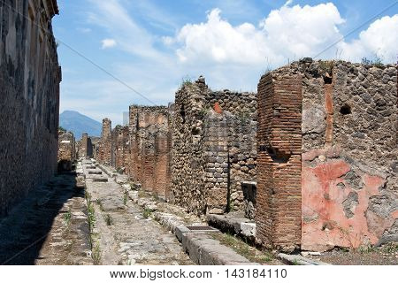 POMPEII, ITALY, MAY 10, 2012: View on one of the streets of Pompeii, which was destroyed in 79 AD from the nearby volcano Vesuvius