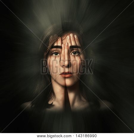 Surreal portrait of a young girl covering her face and eyes with her hands.Double exposure