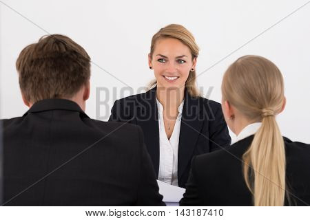 Happy Young Businesswoman Conducting Interview In Office