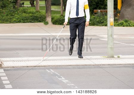 Blind Person With White Stick Walking On Street