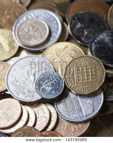 Different world change coins closeup shot. Side lighting
