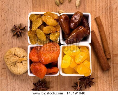 Dried dates apricots  kumquats and raisins in a bowls top view