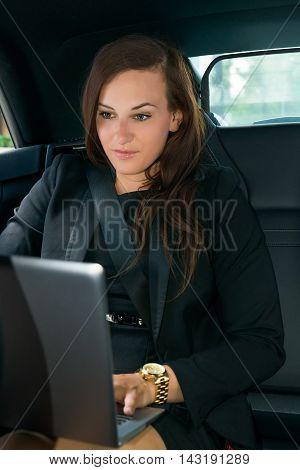 Portrait Of Smiling Young Businesswoman In The Car