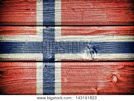 flag of Norway painted on old grungy wooden background: 3d illustration