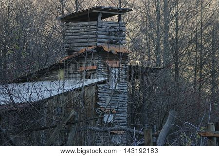 Wooden tower in the forest additional building autumn V