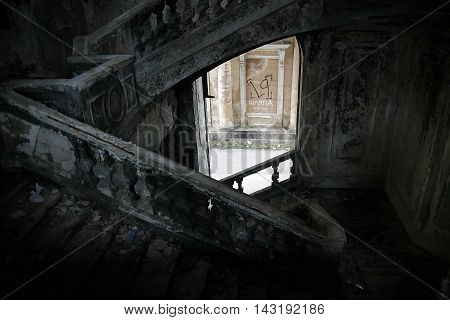 Stone staircase in an abandoned building hat V