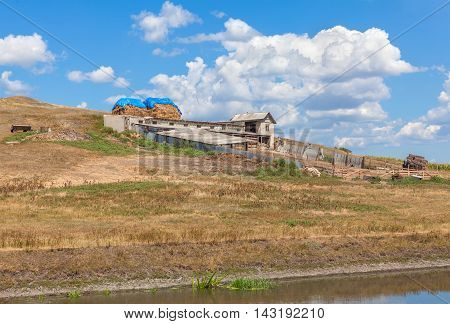rustic farm with old barns on the hill