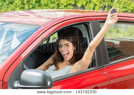 Portrait Of Excited Young Woman Showing Car Key