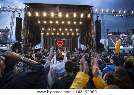 Bontida, Romania - July 16, 2016: Crowd of people at Dub Pistols live concert at Electric Castle festival, one of the biggest music festivals in Romania