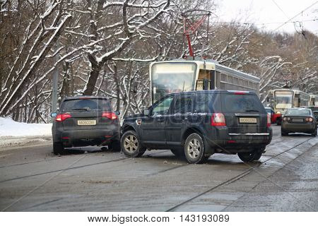 Car accident on city road with tramways at winter day in Moscow, Russia